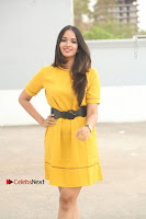Actress Poojitha Stills in Yellow Short Dress at Darshakudu Movie Teaser Launch .COM 0025.JPG