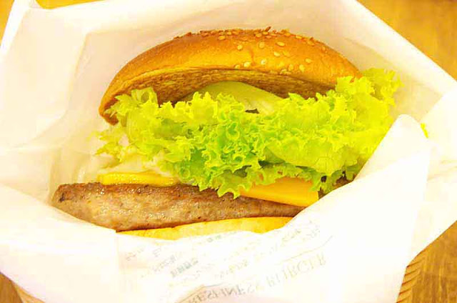 cheese, hamburger,lettuce, fried onion,pumpkin bun