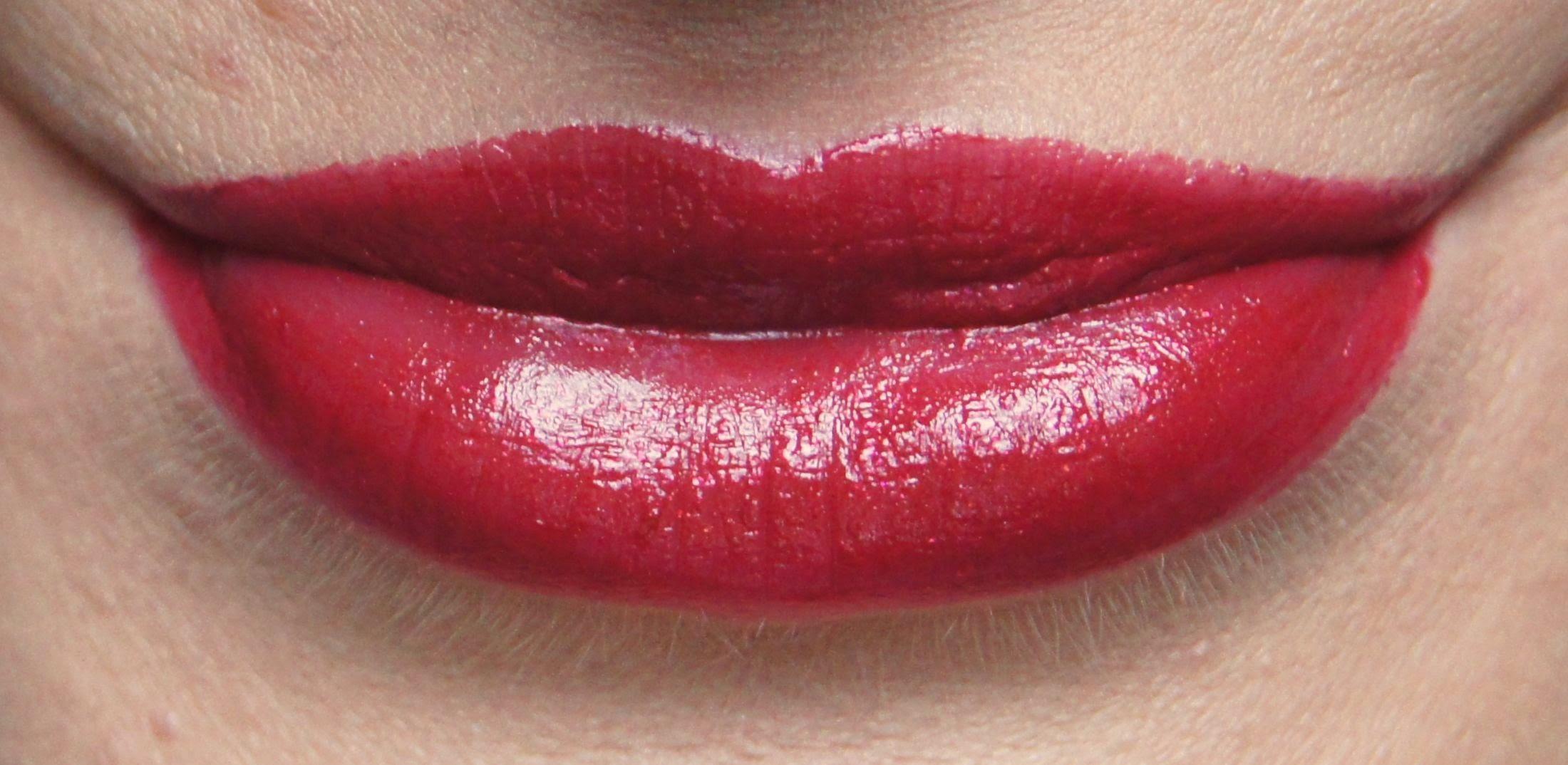 estee lauder pure color vivid shine lipstick forbidden apple swatch review