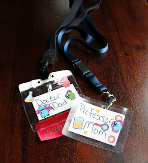 lanyards with name tags in them, doctor dad, professor mom with science themed sticker decorations