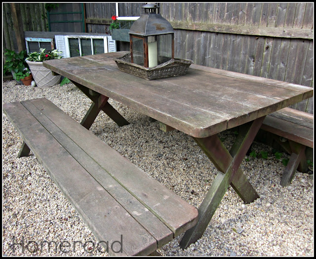 old weathered picnic table with benches