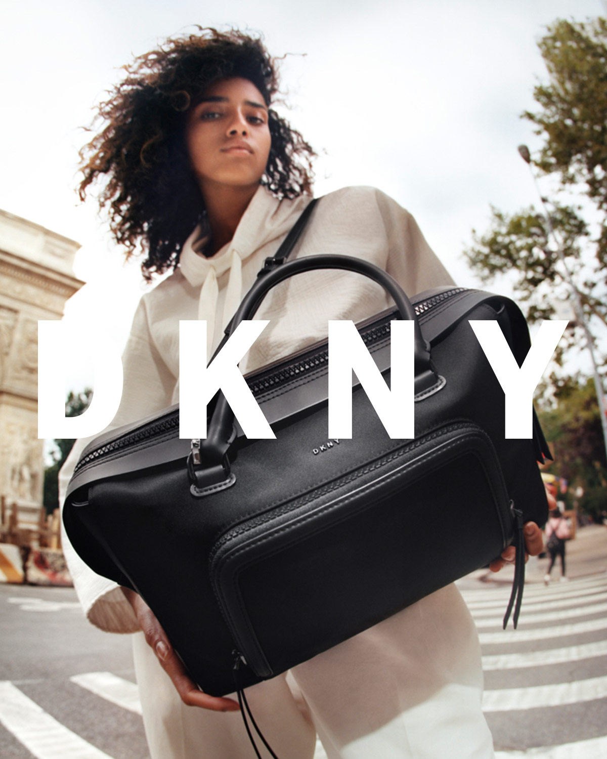 Imaan Hammam by Tyrone Lebon for DKNY Pre-Spring 2017