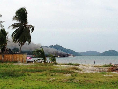 Raja ferry burning at the pier near Nathon
