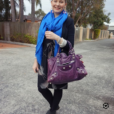 instagram awayfromtheblue black dress for the office with blue scarf, purple balenciaga work bag pink earrings