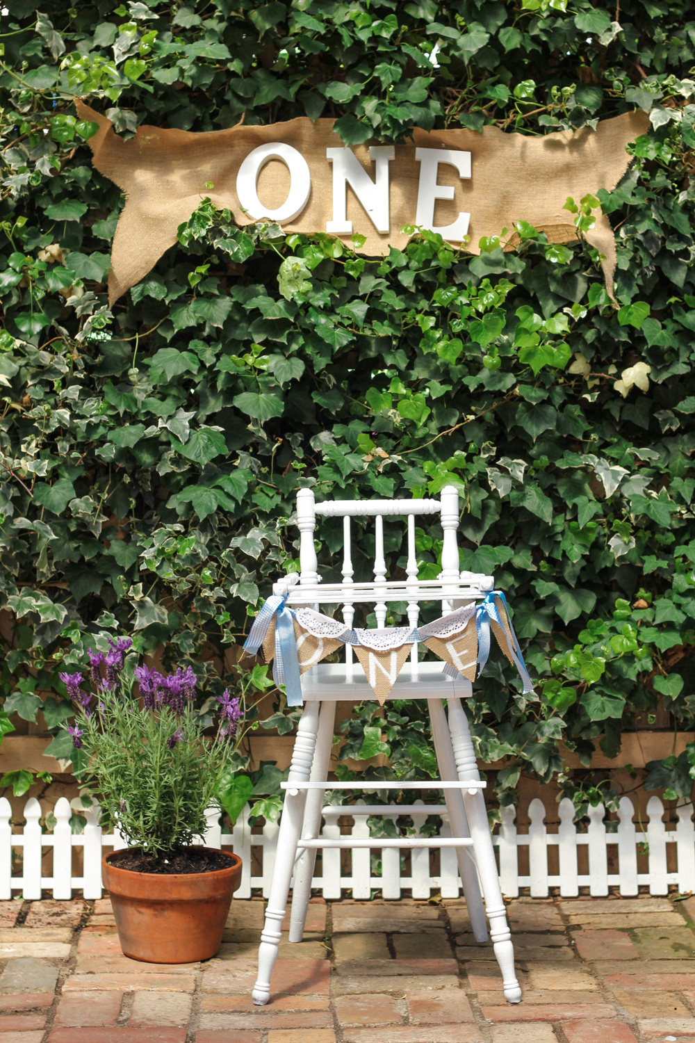 Vintage baby high chair and bunting for babys Peter Rabbit themed first birthday
