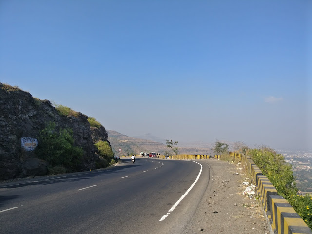 top of ghat with people travelling on it