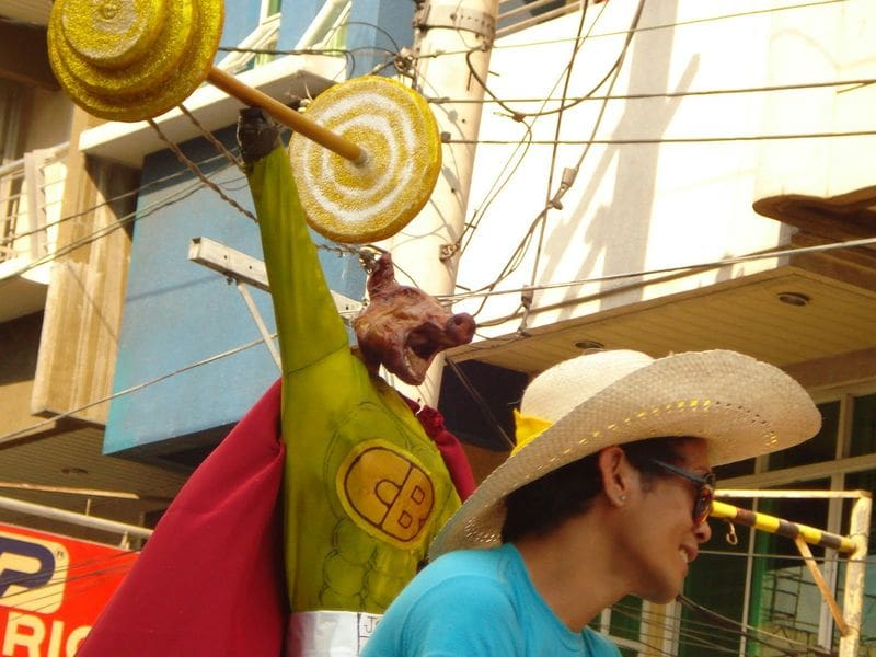 Lechon dressed as Captain Barbell during the La Loma Lechon Festival
