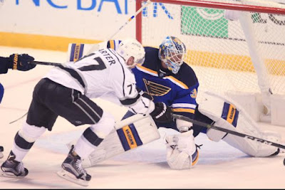 Jake Allen gets a skate on the puck before the stick of Los Angeles Kings Jeff Carter