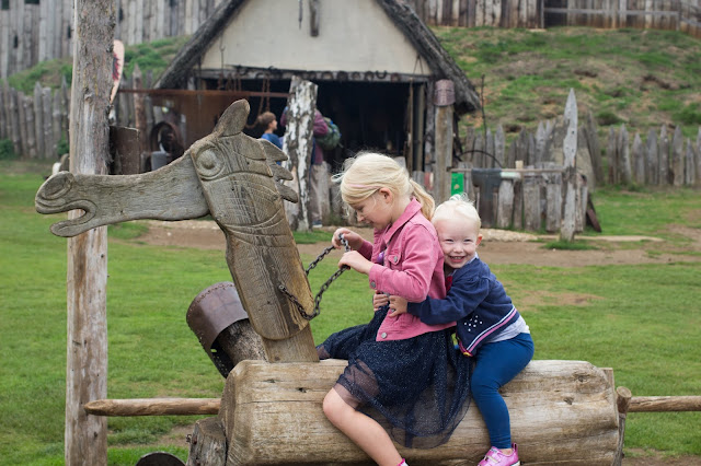 2 children on a wooden horse