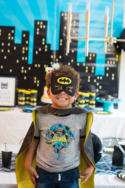 Little Birthday Boy at a Batman Party wearing a Batman Cape and mask