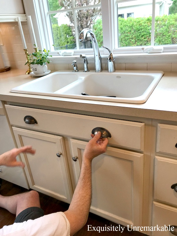 How To Remove Panel Under Sink by pulling it