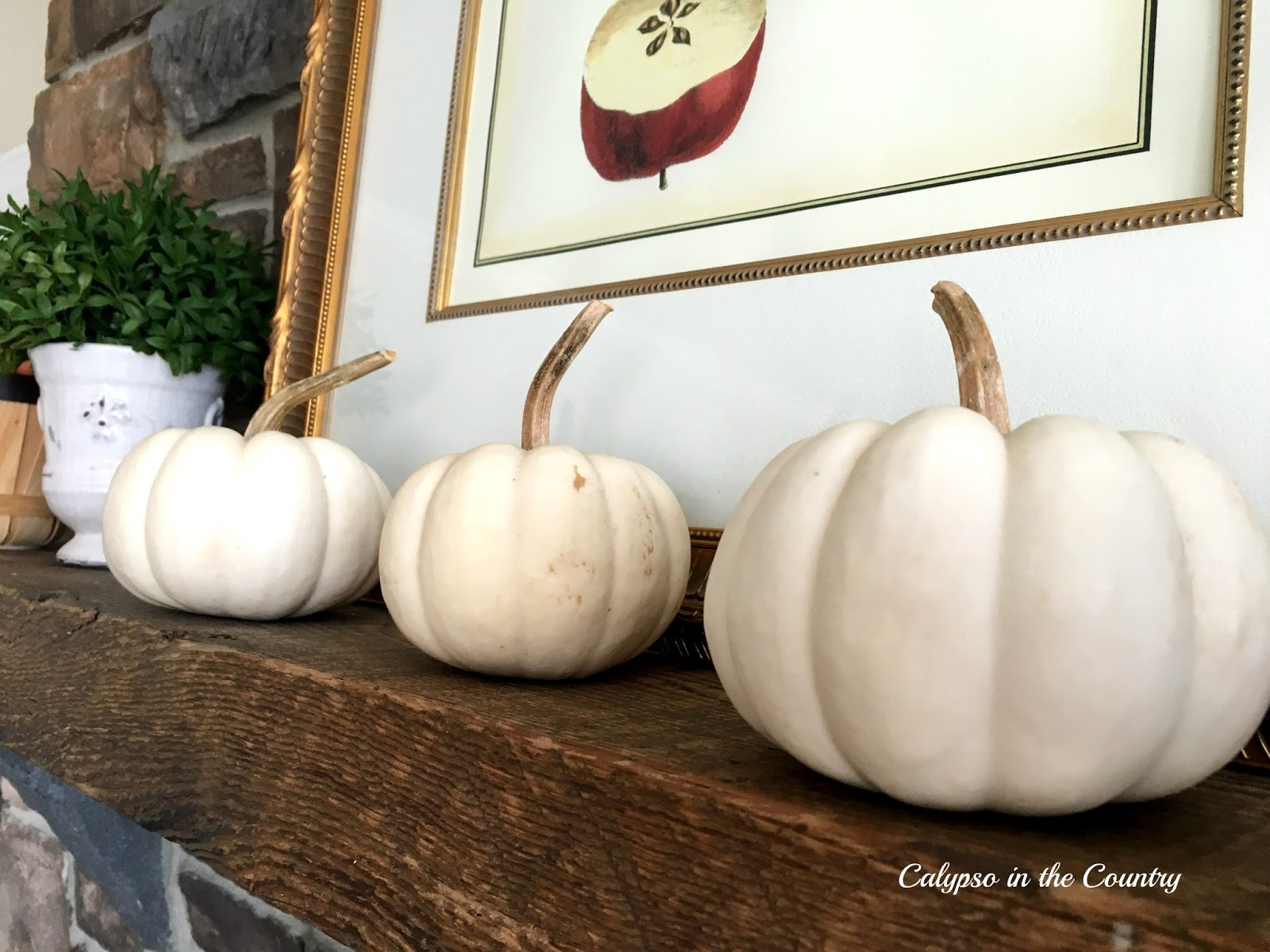 Fall mantel with apples and white pumpkins - decorating ideas for white pumpkins