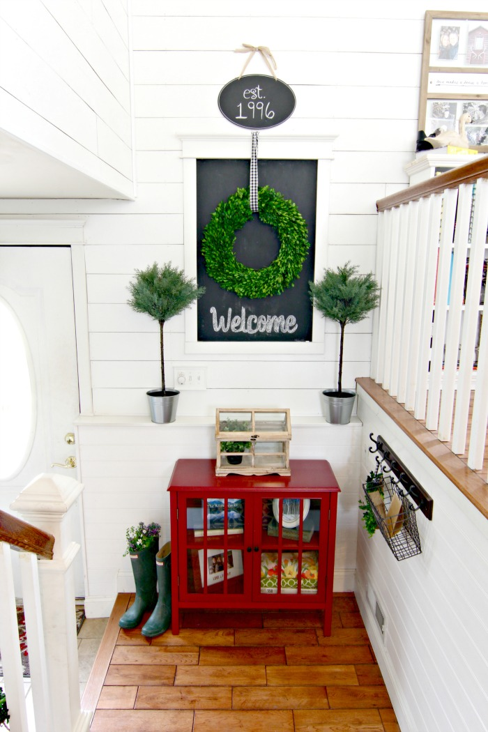 DIY entryway with wall planking and chalkboard, preserved boxwood wreath, and Ikea topiaries - www.goldenboysandme.com