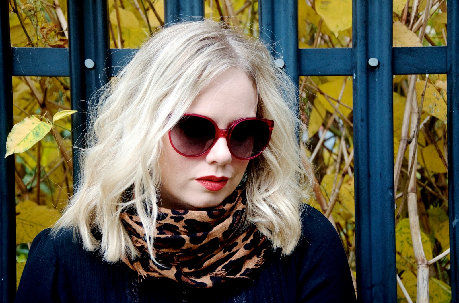 Leopard scarf, Autumn leaves, black blouse, pink sunglasses and red lipstick