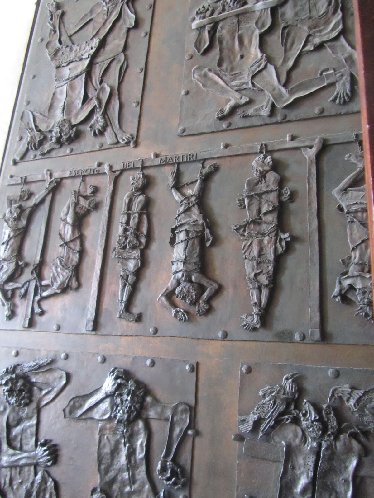 The doors on the far left are known as the Doors of Death as funeral processions pass through here. The gruesome depictions of martyrdoms on the panels were ... & Rome From Home: Rome 365 - St Peter\u0027s Basilica