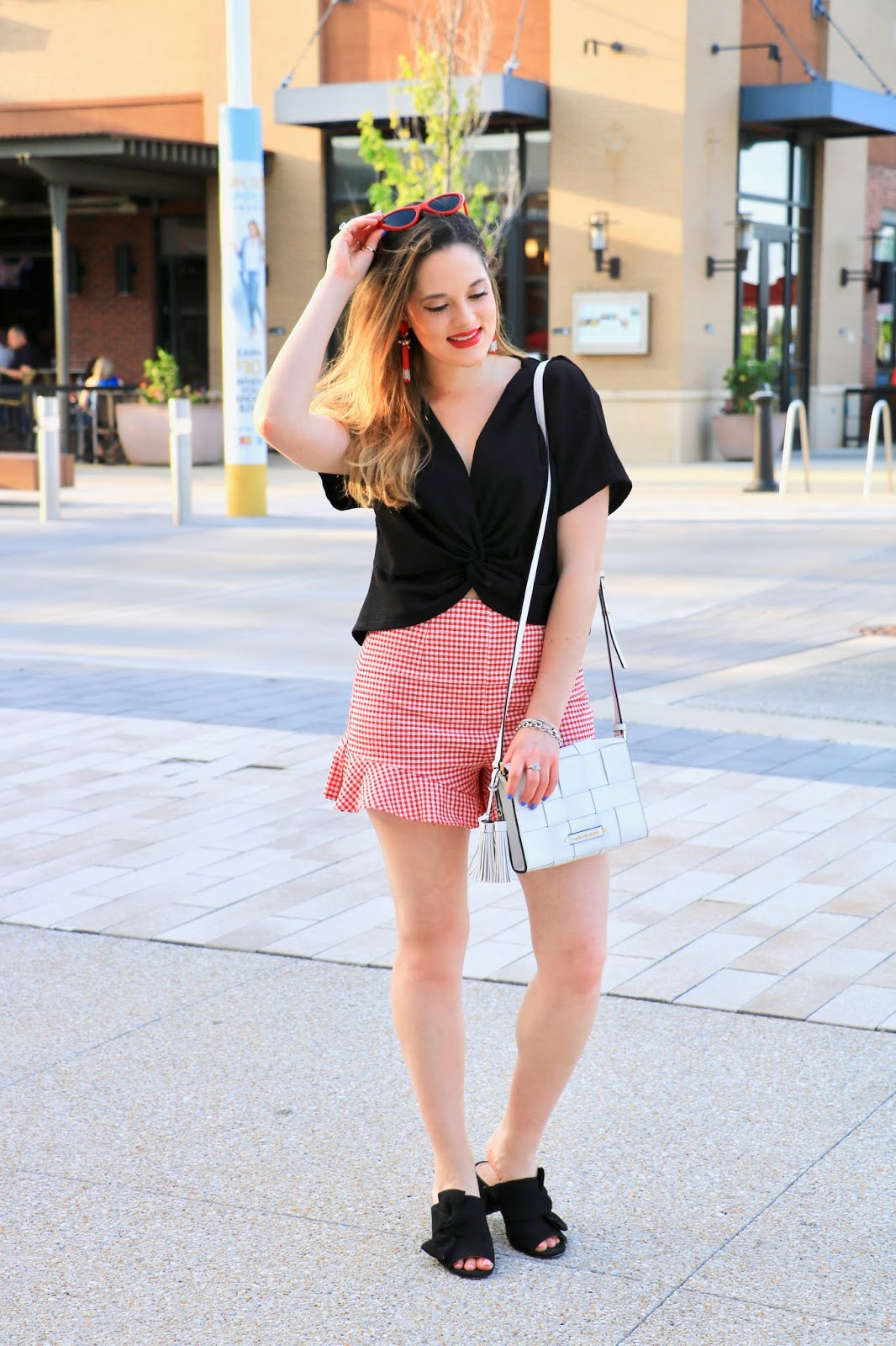Nyc fashion blogger Kathleen Harper showing how to wear a twist crop top