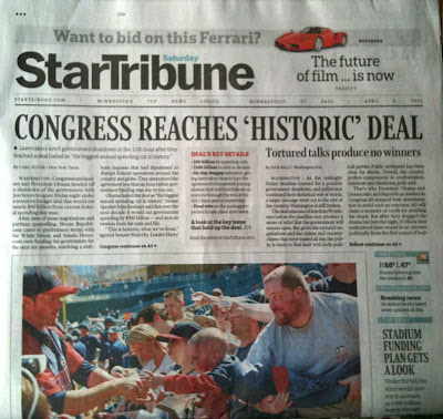 Front page of Star Tribune with photo of young boy reaching toward baseball player