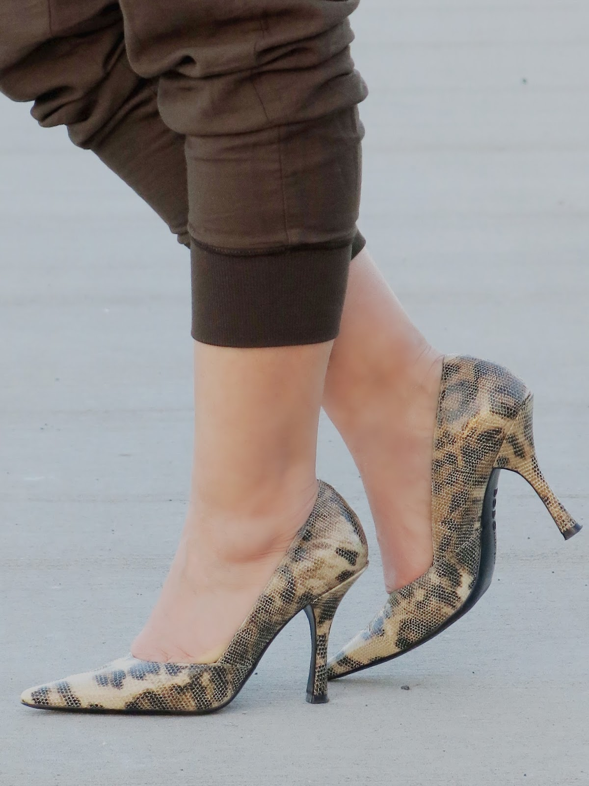 cargo pants and reptile-print pumps