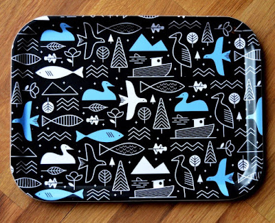 tray with fish, birds and ducks - dark background with white and light blue images