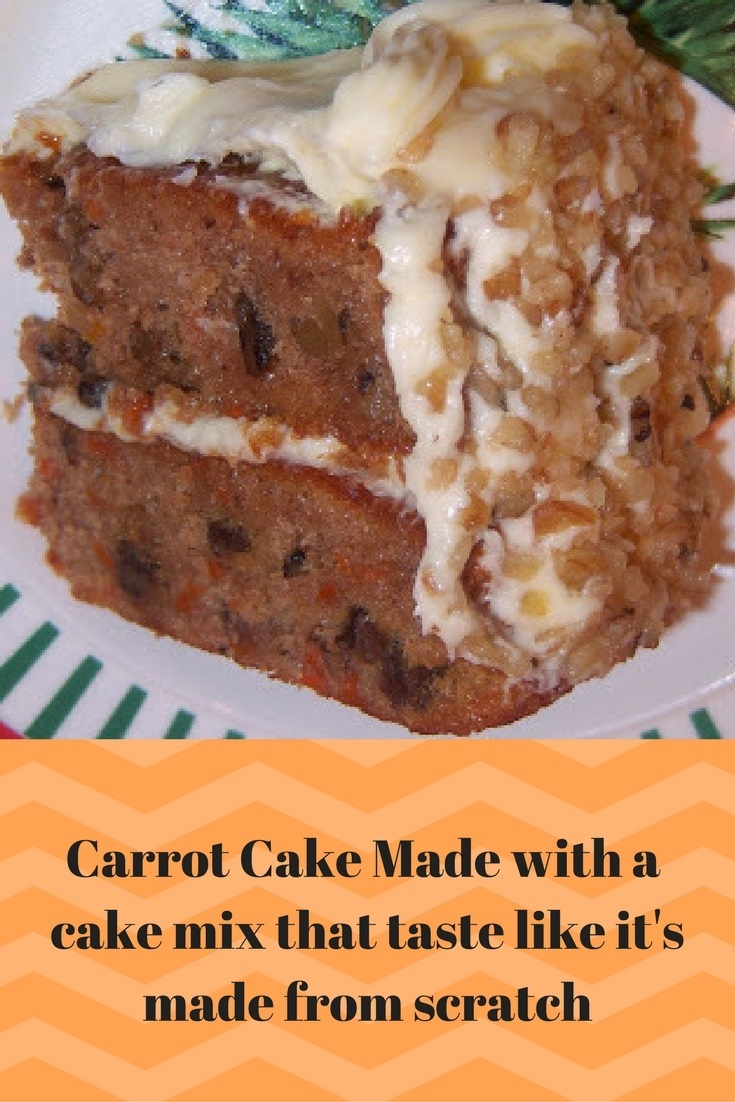 this is a carrot cake made with a cake mix doctored up to taste like it from scratch. This semi homemade carrot cake taste just like you made it from scratch and will fool everyone. This photo has a cream cheese frosting with nuts and raisins on top covering a cake mix version of homemade carrot cake.