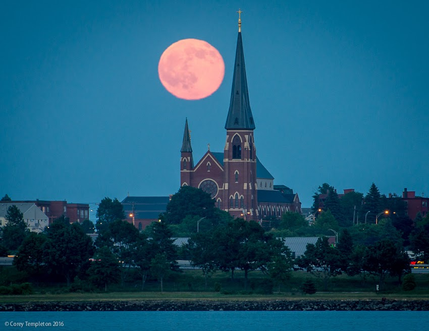 Portland, Maine USA June 2016 photo by Corey Templeton. Full moon rising beyond the Cathedral of The Immaculate Conception. Viewed from across Back Cove