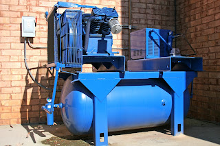 Industrial air compressor located outdoors