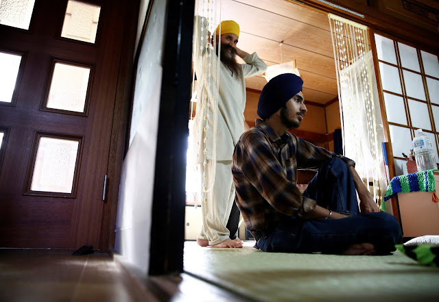 Image Attribute: Gursewak Singh (R) and his father Bharpoor Singh are seen in the living room of their house during an interview with Reuters in Matsudo, Japan, September 25, 2016. REUTERS/Kim Kyung-Hoon