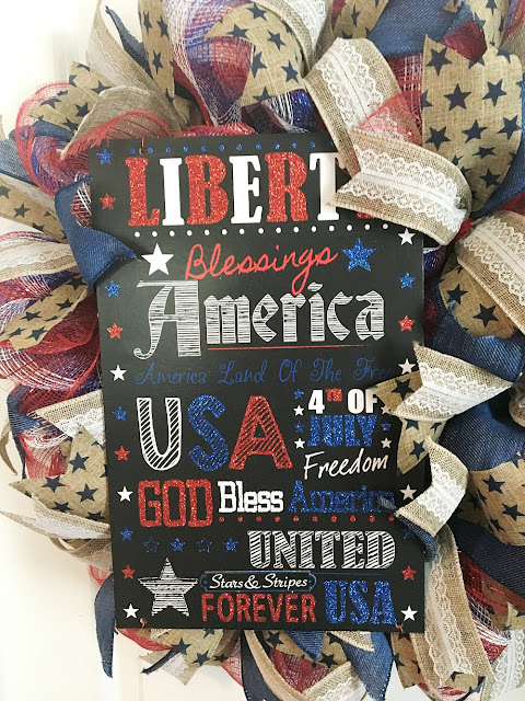 Vintage Paint and more... a patriotic wreath made of deco mesh and beautiful wire edged ribbon featuring a patriotic glittered sign