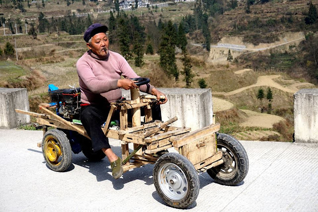 "Farmer races to market in homemade ""BMW"""