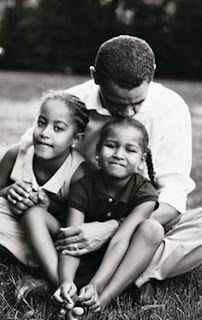 First Dad Barack Obama and his daughters.