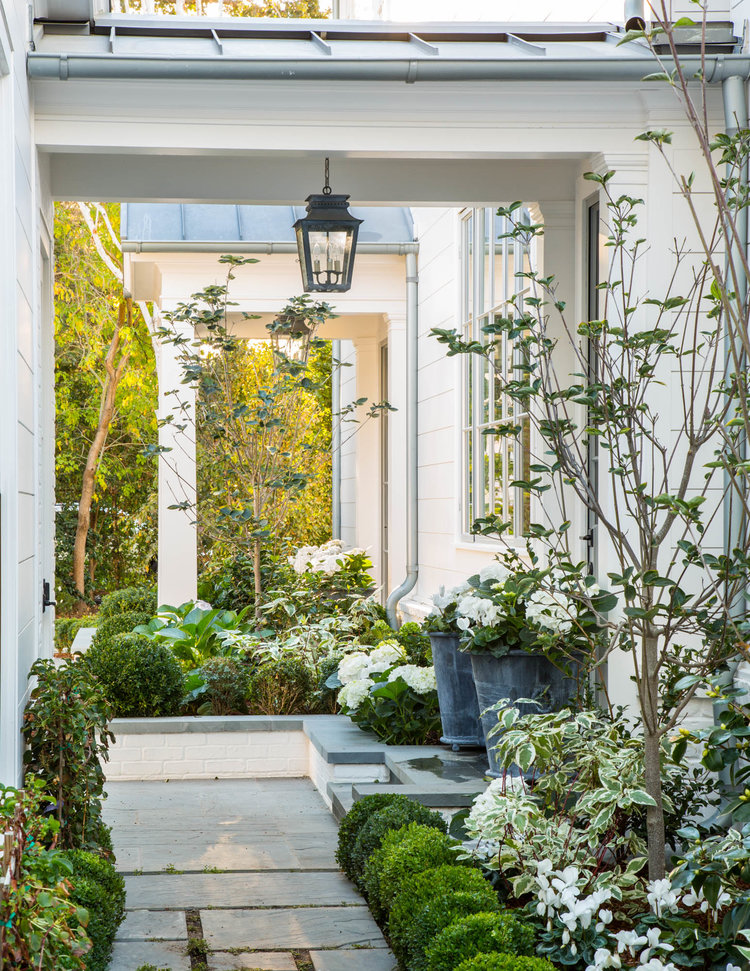 Beautiful modern farmhouse style exterior with green and white (Giannetti Home) inspiration on Hello Lovely Studio