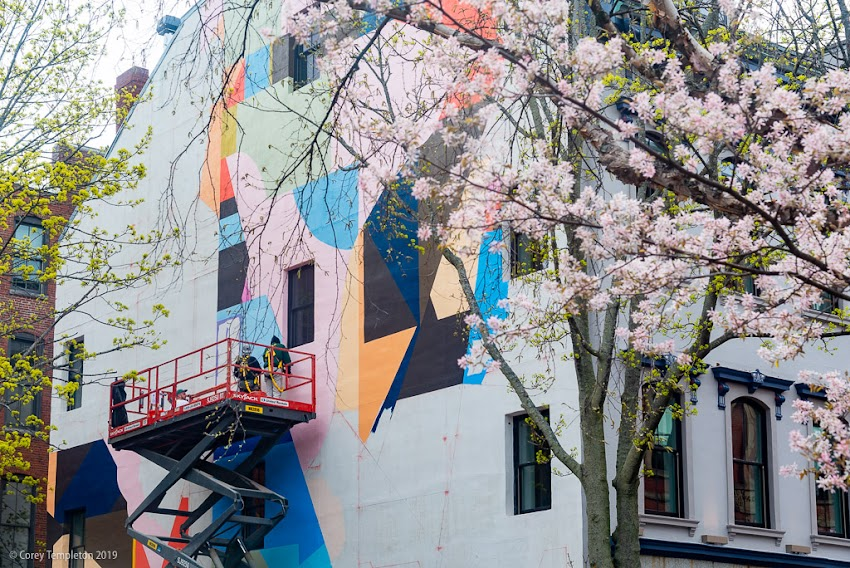 May 2019 Portland, Maine USA Photo by Corey Templeton. An in-progress shot of the new mural on Exchange Street, overlooking Tommy's Park, by local artist Will Sears. I dig it!