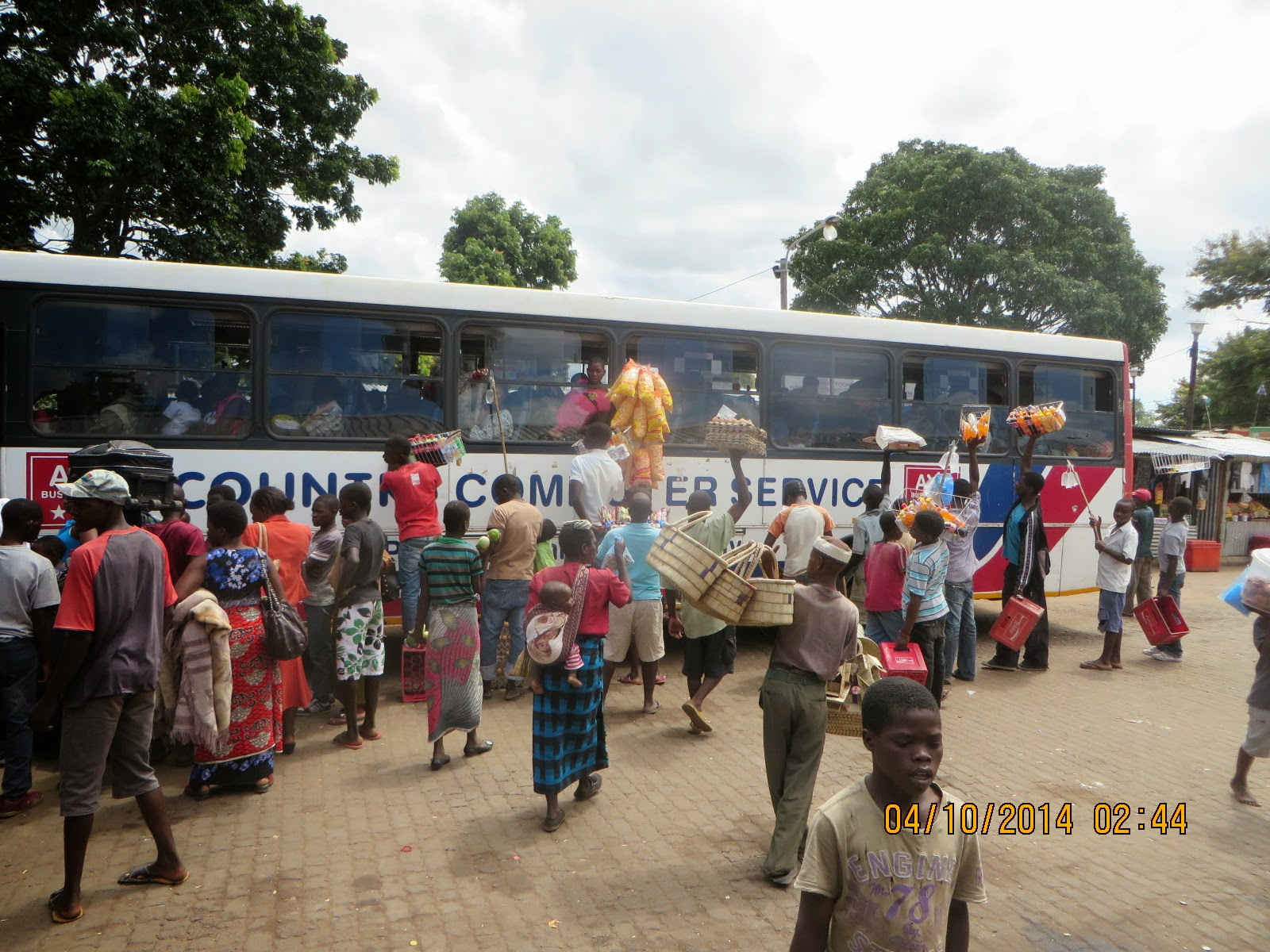 Chicken bus already full, and all those waiting will be added still ... Salima, Malawi