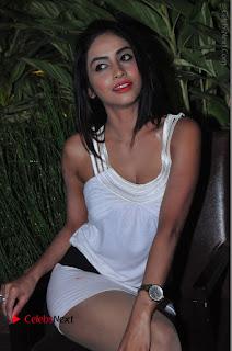 Actress Model Pooja Sri Stills in White Short Dress at F Club pre soft Launch  0225.JPG