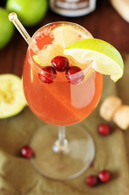Sparkling Cosmopolitan Image ~ Perfect for girls' night in, brunch, or a random Tuesday.  Or, with it's beautiful cranberry base and garnish, for Thanksgiving sipping, too