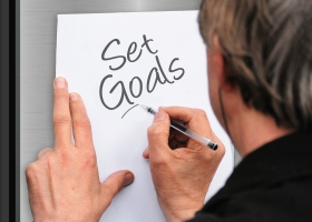 A man thinking of setting goals.