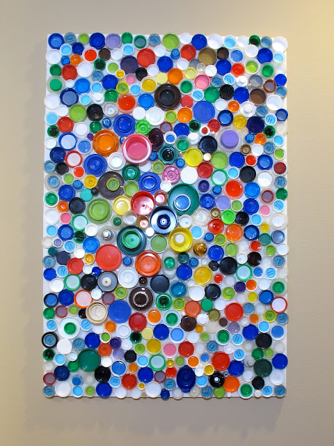 upcycled plastic bottle cap wall art