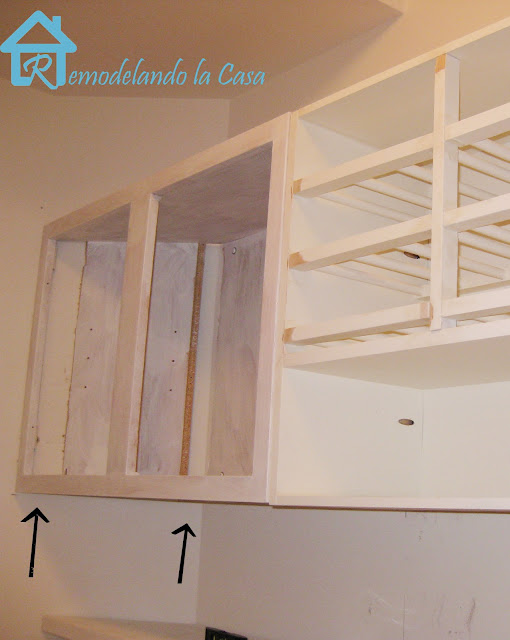 short cabinets in laundry room brought up to the ceiling