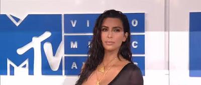 Kim Kardashian West Pours on the Sexy