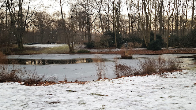 Tiergarten with snow; a lake and a sculpture