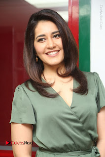 Actress Raashi Khanna Stills in Green Short Dress at Mirchi 95 Suno Aur Mercedes Jeeto Contest  0108.JPG