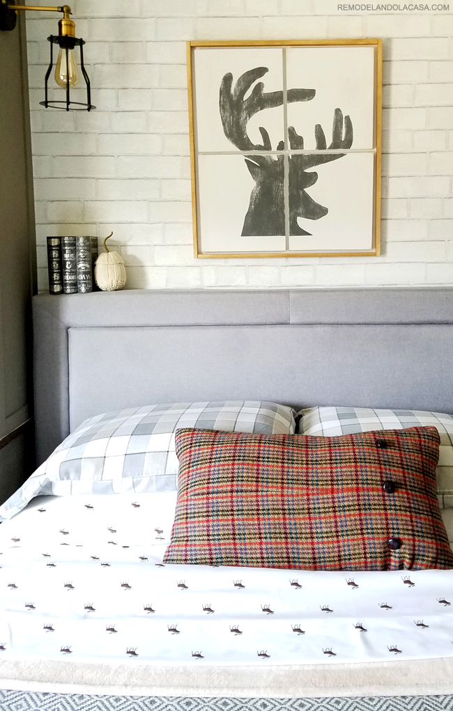 deer head wall art, grey bed and fall accents in this teen boy room