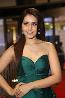 Raashi Khanna in Dark Green Sleeveless Strapless Deep neck Gown at 64th Jio Filmfare Awards South ~  Exclusive 140.JPG