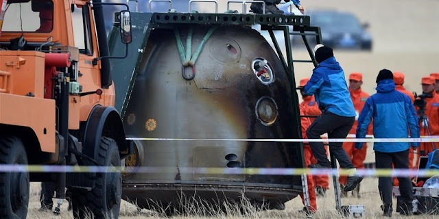 The Shenzhou 11 spacecraft's re-entry capsule seen after the successful landing on Nov. 18. Photo Credit: Ren Junchuan / Xinhua
