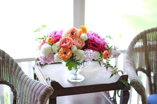 Wedding Centerpieces compote urn vase filled with garden roses ranunculus jasmine vine passionflower fine viburnum pink orange blush coral Sweet Pea Floral Design Ann Arbor