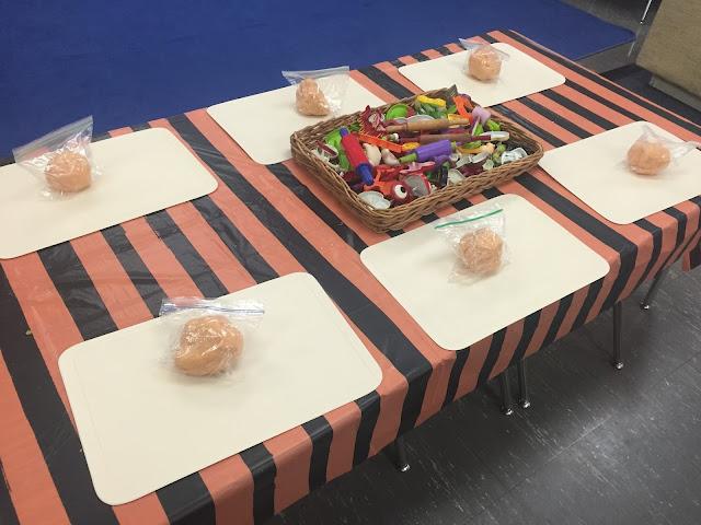 adding pumpkin play dough and pumpkin faces to your dough center for your kindergarten halloween party