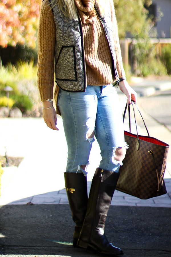 chunky knit sweater with ripped jeans and boots