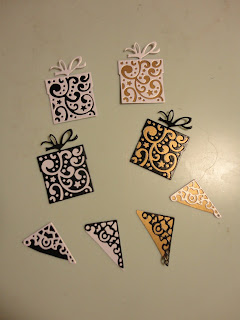 Die cut presents and corners in black, gold and pearl white