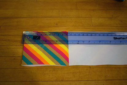 plastic ruler measuring strip of multicoloured paper