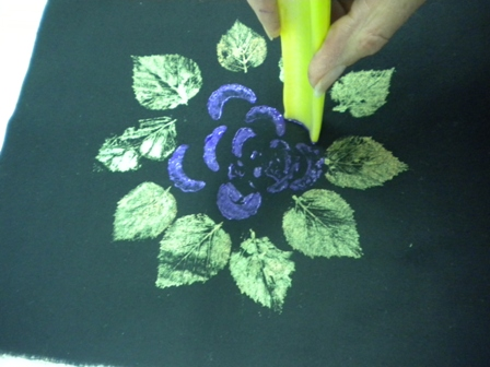 ... leaves onto the surface of the fabric creating a negative print. When